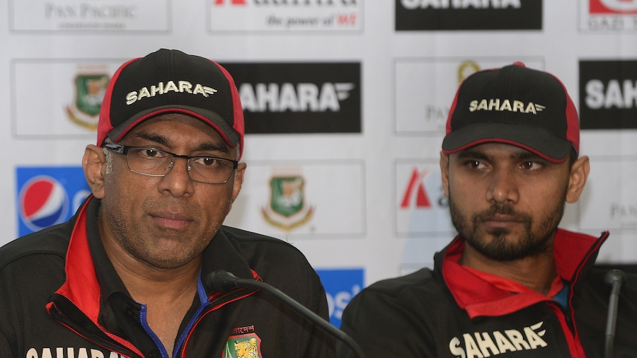 Bangladesh head cricket coach, Chandika Hathurusinghe (L)speaks as Bangladesh captain, Masrafe Bin Mortaza looks on during a media conference at the Sher-e-Bangla National Cricket Stadium in Dhaka on January 22, 2015.  Bangladesh play their first match of the Cricket World Cup 2015 against Afghanistan in Canberra, Australia on February 18.  AFP PHOTO / Munir uz ZAMAN        (Photo credit should read MUNIR UZ ZAMAN/AFP/Getty Images)