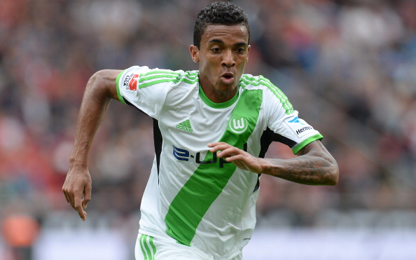 Wolfsburg's Brazilian defender Luiz Gustavo runs during the German first division Bundesliga football match Bayer Leverkusen vs VfL Wolfsburg in Leverkusen, western Germany, on September 14, 2013.  Leverkusen won 3-1. AFP PHOTO / PATRIK STOLLARZ RESTRICTIONS - DFL RULES TO LIMIT THE ONLINE USAGE DURING MATCH TIME TO 15 PICTURES PER MATCH. FOR FURTHER QUERIES PLEASE CONTACT DFL DIRECTLY AT + 49 69 650050.        (Photo credit should read PATRIK STOLLARZ/AFP/Getty Images)