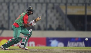 Bangladesh cricketer Mohammad Mahmudullah plays a shot during the second One Day International match between Bangladesh and South Africa at the Sher-e-Bangla National Cricket Stadium in Dhaka on July 12, 2015. AFP PHOTO/ Munir uz ZAMAN        (Photo credit should read MUNIR UZ ZAMAN/AFP/Getty Images)